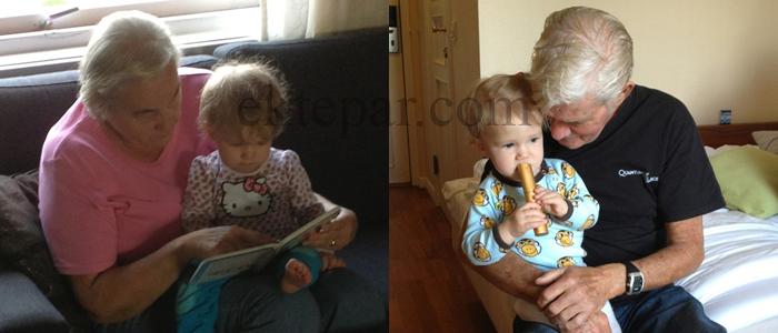 GAMLISER: Farmor leser bok og farfar hjelper til med å spise opp etuiet med brillene til farmor.